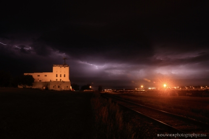 Lightning storm over the Texas Refinery Corp building and Canadian Pacific Railway yard.